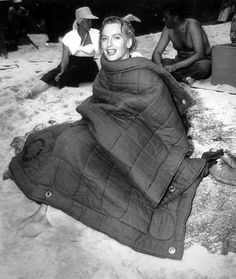 Deborah Kerr keeps warm during the filming of the famous beach scene of From Here to Eternity