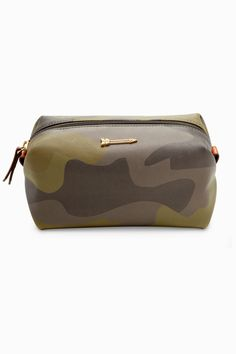 This multi-tasking pouf, now in a saffiano camo print, organizes you in  style. Use it for everything from cosmetics to tech cords. 6178ed98ce5
