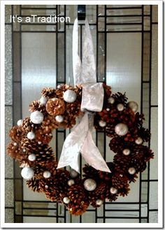 pinecone and silverball wreath....put cinnamon in the pinecones to welcome your guests as they walk in the door :)