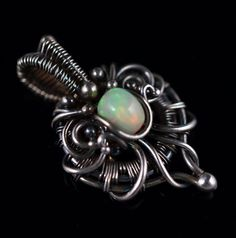This amazing pendant has a stunning Ethiopian opal as eyecatcher. The opal pendant has been created with hand formed, sterling and fine silver. The silver wire has been oxidized and polished to give depth, bring out detail and give a romantic vintage look. by atelierblaauw