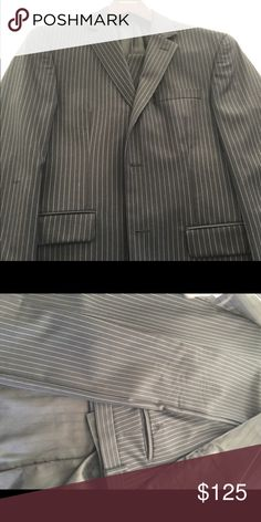 Michael Kors 38R Men's Navy pinstriped suit I am selling a like new 38R Michael Kors Men's pinstriped suit. Suit has just sat in my closet and has only been worn once. Michael Kors Suits & Blazers Suits