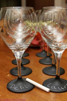 For a party... buy cheap wine glasses then paint bottoms with chalkboard paint