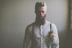 Beardy Groom with braces & large buttonhole - Image by James Melia - Bohemian Bride Inspired Wedding Shoot At The Arches Dean Clough Halifax With Rustic Wild Flowers And Delicious Food From Eat Me Drink Me With Images From James Melia Photographers