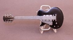 Vintage Electric Guitar belt buckle available at our eBay store! $25
