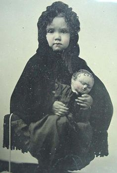 Girl with large doll
