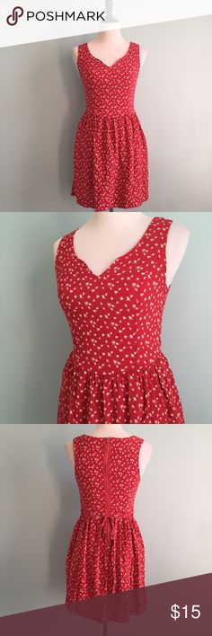 Red Starry Dress Red dress with white star pattern. Drop-waist and tie in the back. Size medium by Xhilaration. Xhilaration Dresses