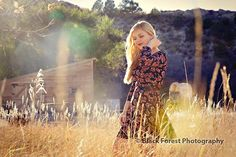 Country, fashion high school senior photography in Colorado Springs, Colorado with a barn by Black Forest Photography http://www.blackforestphoto.com Outdoor girl senior photo shoot at Rock Ledge Ranch #seniorpictures #girlsseniorphotos #seniorphotoshoot #highschoolseniorphotographer #coloradospringshighschoolseniorphotographer