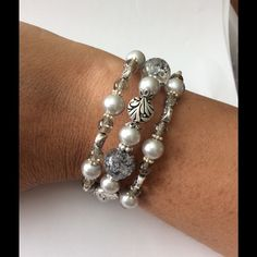 Silver/Grey glass bracelet.Design & handmade by JJ Hand made and designed by Josefina Jewelry. This is 3 strands that wraps itself around your wrist. Silver glass pearls, light grey cracked glass, and silver plated bearings. Handmade Jewelry Bracelets