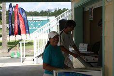USTA Leagues Coordinator, Dona Garcia, stops in at the Tournament Desk