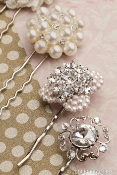 "Whether you sweep your wedding-day tresses into a chic updo or let them loosely cascade around your shoulders, add some sparkle with vintage-style hair accessories. Simply glue buttons and baubles to bezel-equipped bobby pins. TIP: Search antique stores, online auctions and Grandma's sewing basket for old buttons, and you can cross ""something borrowed"" off your list."