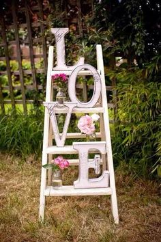 #Vintage# ladder styled for  #wedding#. Pretty sure this would be easy & cheap to make for random wedding decor. Maybe by the gift or old wedding photo tables. Cheap thrift store ladder, painted. Letters from craft store painted & given a vintage look. Fake #flower#s in jars.