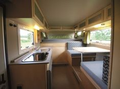 $113k 79sqft Mercedes Sprinter Bimobil RV conversion. Twin bed extends over dinette to become full.