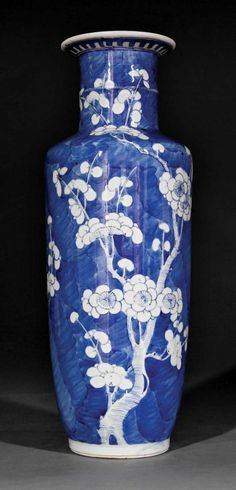 A Chinese Blue and White Porcelain Rouleau Vase, probably Qing Dynasty (1644-1912), decorated with flowering prunus branches against a cracked ice ground, base with Kangxi mark, height 14 3/8 in