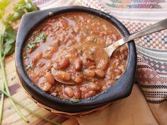 Do side dishes at potlucks and cookouts ever give you trouble? They're trouble for me. The ideal potluck or cookout dish is one that's easy to make in bulk and inexpensive, and doesn't degrade with extended heating or reheating. I nominate frijoles charros—Mexican cowboy beans cooked with onions, garlic, tomatoes, salted pork, and chilies—as one superlative potluck dish.