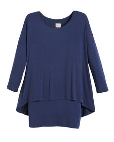A layered hem gives this scoop neck top the look of a perfect pairing in one easy piece.