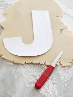 How to make a Letter Cookie Cake - - Giant cookie cakes are all the rage in the baking world. I first saw this style of cookie cake from Israeli baker, Adi Klinghofer. Her letter and number cakes are typically covered in fresh flowers,. Rainbow Cookie Cake, Giant Cookie Cake, Cookie Cake Birthday, Jenny Cookies, Fun Cookies, Cake Cookies, Cupcake Cakes, Cupcakes, Alphabet Cake