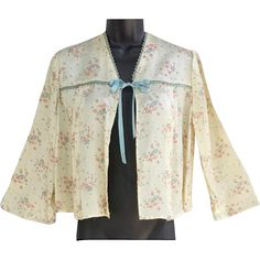 1940s satin bed jacket in a feminine floral rose print; size medium - large.  Bust 36, Length 20 from center back to hem and sleeves at 3/4 length.