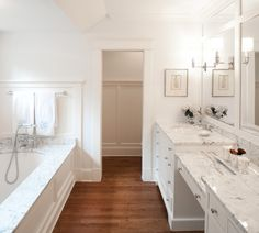 Beautiful bathroom design with drop-in bath featuring a marble surround and paneled exterior.