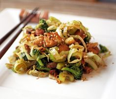 Chicken and Vegetable Lo Mein.1 Tbsp Sesame Oil, toasted 1 T Garlic 1 T Ginger Root 1 lb Skinless Chicken Breast, cubed 1/2 c Water Chestnuts 2 c Broccoli 1/2 c Shiitake Mushrooms, stems removed and cut in half 1/4 c Almonds 1/4 c Celery 1/4 c Green Onion 2 c shredded Green Cabbage 1/4 c Coconut Aminos 1 tsp Sesame Seeds