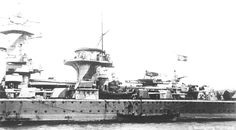 Another port side view of Admiral Graf Spee. Here the destroyed Arado Ar196 aircraft and damage to the hull can be seen.