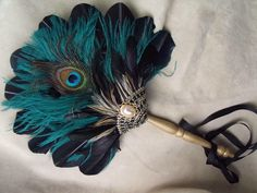 Peacock feather fan. Be good for a photo.