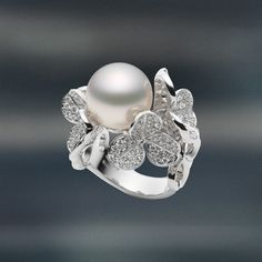 #Mikimoto's Fortune Leaves collection includes a series of captivating three-leaf clover designs that envelope the lustrous White South Sea #pearl.  #PearlMonth #MikimotoPearlMonth