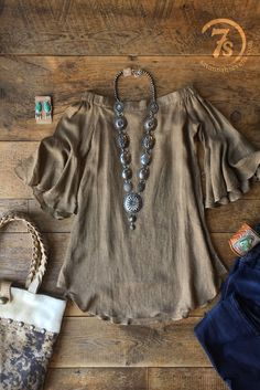 The Sioux Falls off the shoulder shirt with silver concho necklace