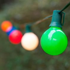 Illuminate your backyard with colorful outdoor commercial light strings. Opaque light bulbs on green wire hang outdoors for patio string lighting. Outdoor Party Lighting, Patio Lighting, Lighting Ideas, Lighting Design, Globe String Lights, Light String, Hanging Patio Lights, Solar Light Crafts, Jar Lights