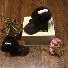 UGG's Australia baby boo boots Brand new w tags in box with authenticity paper. Super adorable dark brown toddler UGG's. Elastic lace up back to keep boots on snug. Suede w plush sheepskin size medium infant 4-5 18-24 months runs big UGG Other