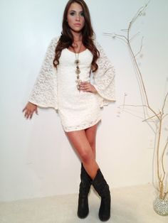 White lace dress with cowboy boots . A fun twist for an outdoor wedding . A cute idea for all your bridesmaids too . Dress by www.shopshapes.com