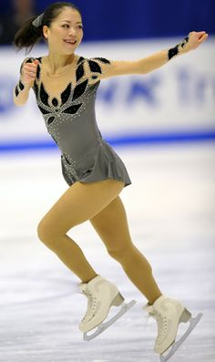 Happy lady - I would be too if I was wearing this cool leotard design. It's Akiko Suzuki, ISU Grand Prix of Figure Skating 2011/2012, NHK Trophy, SP    +