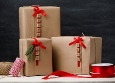 This DIY gift wrapping idea is simple and beautiful! Get the steps and the supplies on our blog. #giftwrap #OTCraftyChristmas #diy #christmasgifts #giftwrappingideas #orientaltrading