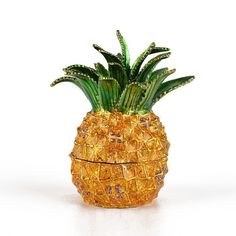 """""""Pretty #Pineapple Trinket Item No. KB00577A01 $27.29 This pretty pineapple would be a lovely gift for just about anyone. It opens and closes easily and securely, and there is enough room inside to hold numerous small mementos. The pineapple gift box is about 3 1/2"""" tall and about 3"""" wide. It has texture and gold plating, as well as a few violet hued crystals. Made from pewter."""" Pineapple Gifts, Keepsake Boxes, Trinket Boxes, Valentines, Gold Plating, Crystals, Tins, Pewter, Pretty"""