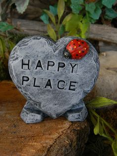 Happy Place Garden Sign Heart Slate with stand and lady bug  - miniature sign for your gnome garden. $10.75, via Etsy.