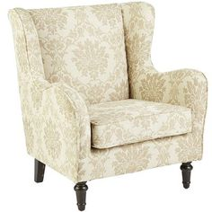 Our update of the classic wingback, this refined chair features a more streamlined silhouette (no tufts), while maintaining the traditional privacy wings, comfy curved arms and turned hardwood legs. Ivory patterned upholstery is self-welted and pulled tight over plush padding.