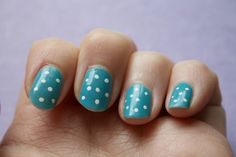 Turquoise spotty nails
