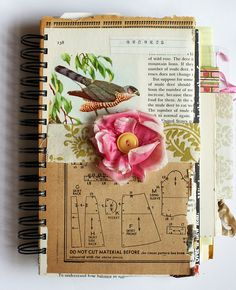 Mixed-media journal ~ cover features vintage image of bird, sewing pattern,  fabric flower with button, and fabric scrap