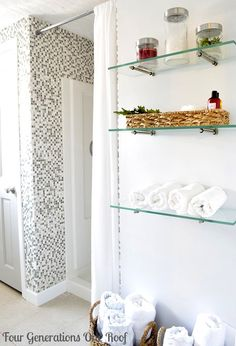 we took our glass shelves and medicine cabinet out of our bathroom and I want to reuse the shelves. This is a good idea :)
