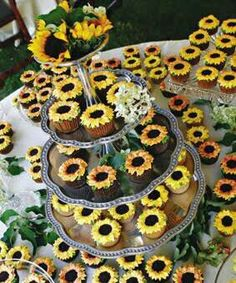 Because Tomas loves sunflowers—and often brings them home for Hilary—the couple thought it would be fun to offer a cheery tower laden with cupcakes frosted with buttercream sunflower florets. Cupcakes by Marie Jackson o Sunflower Wedding Cupcakes, Sunflower Party, Wedding Cakes With Cupcakes, Cupcake Cakes, Daisy Cupcakes, Sunflower Weddings, Sunflower Bridal Showers, Red Sunflower Wedding, Wedding Shower Cakes
