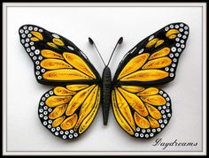 Paper-quilled monarch butterfly, by Suganthi.