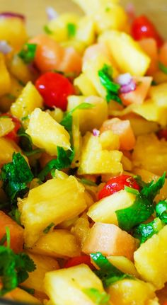 Pineapple mango salsa.  Not just salsa, but a side dish, a snack, or an appetizer.  Healthy, vegetarian, gluten-free, and vegan recipe full of fresh tropical fruit and veggies. Perfect for Cinco De Mayo! | JuliasAlbum.com | #tropical_fruit_recipes #Pineapple_recipes