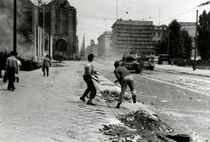 Two men throwing stones at Soviet tanks during the uprising in East Germany on June 17, 1953.