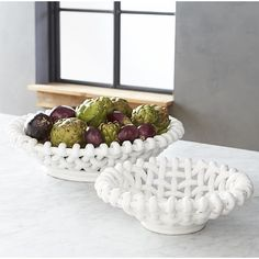 Riviera Woven Bowls I Crate and Barrel -- bread or fruit bowl for the dining table. Really cool.