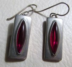"""Jorgen Jensen Modernist Pewter Earrings with Red Glass. Jorgen Jensen DENMARK 230"""". Pewter with red glass oval inset / lovely modernist style. Signed on the back """"PEWTER. 1 1/2"""" drop. Understand that color or image quality as displayed on your computer may not be exactly as the item appears in person, but we do not alter our pictures.   eBay!"""