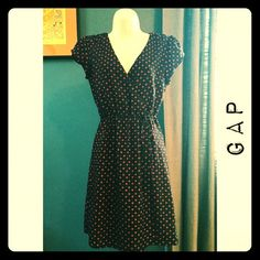 GAP faux wrap dress This print dress is navy and red. It is a faux wrap with a hidden button on the V-neck. Gathered at waist with a skinny belt. Cute cap sleeves on this dress. Can go from day to night- very versatile. Worn several times - in great shape. GAP Dresses