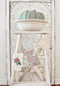chippy white ladder, blue pumpkin, paper banner, lace screen