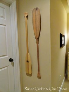 Oh my arctic paddles are so going to be put up like this! canoe paddles as wall decor!  Must do this!