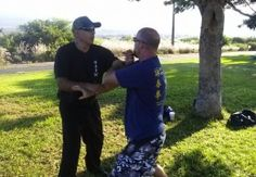 The Wing Chun Chronicles. Lawrence Ramirez Sifu places Lop Dar on Mike Pollard.