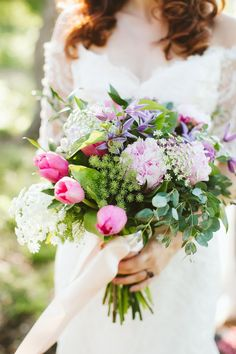 Spring wedding bouquet idea with tulips and greenery {The Flower Girl}