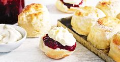 Tuck into these freshly baked scones, served with raspberry jam and cream - the perfect afternoon delight.